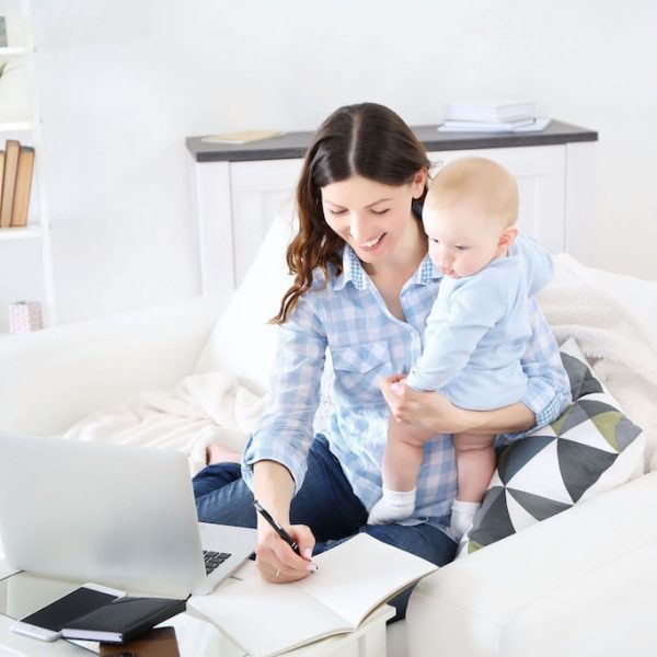 mum working on laptop with baby