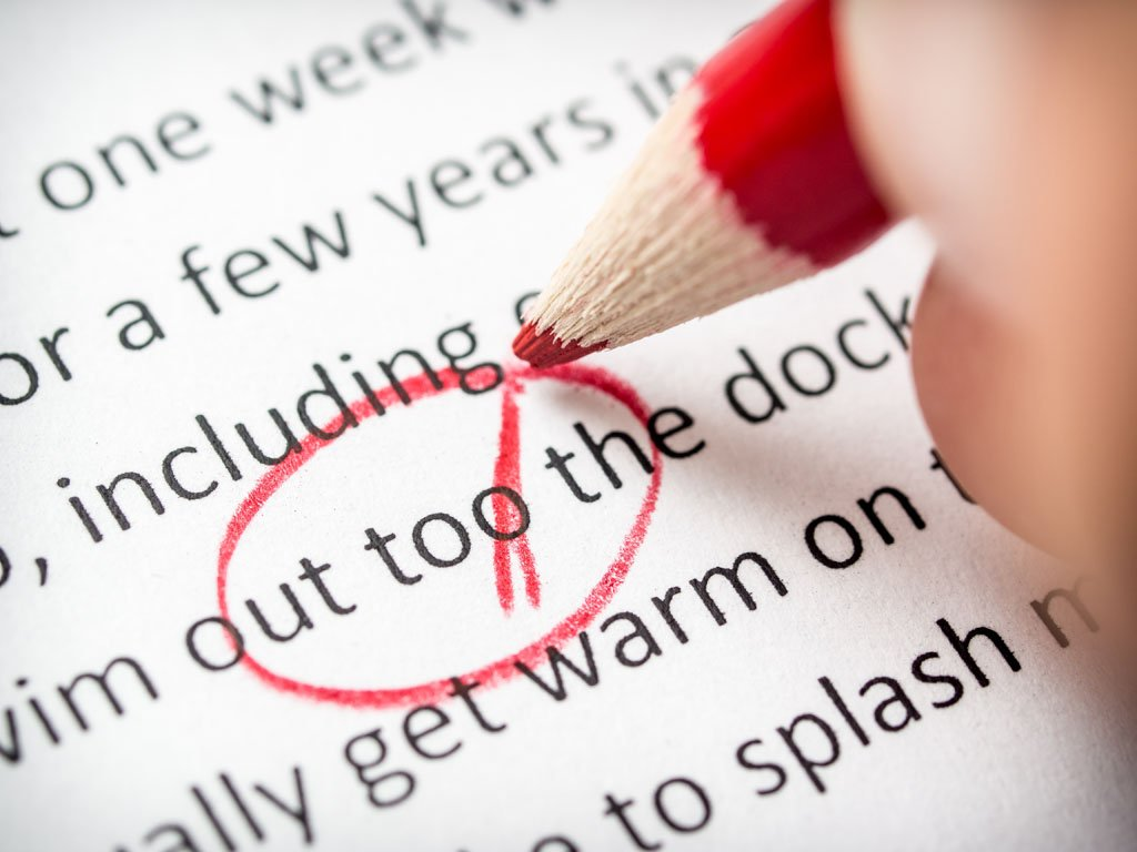 Proofreading with red pencil