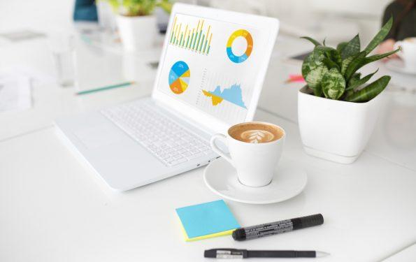 White laptop with statistics